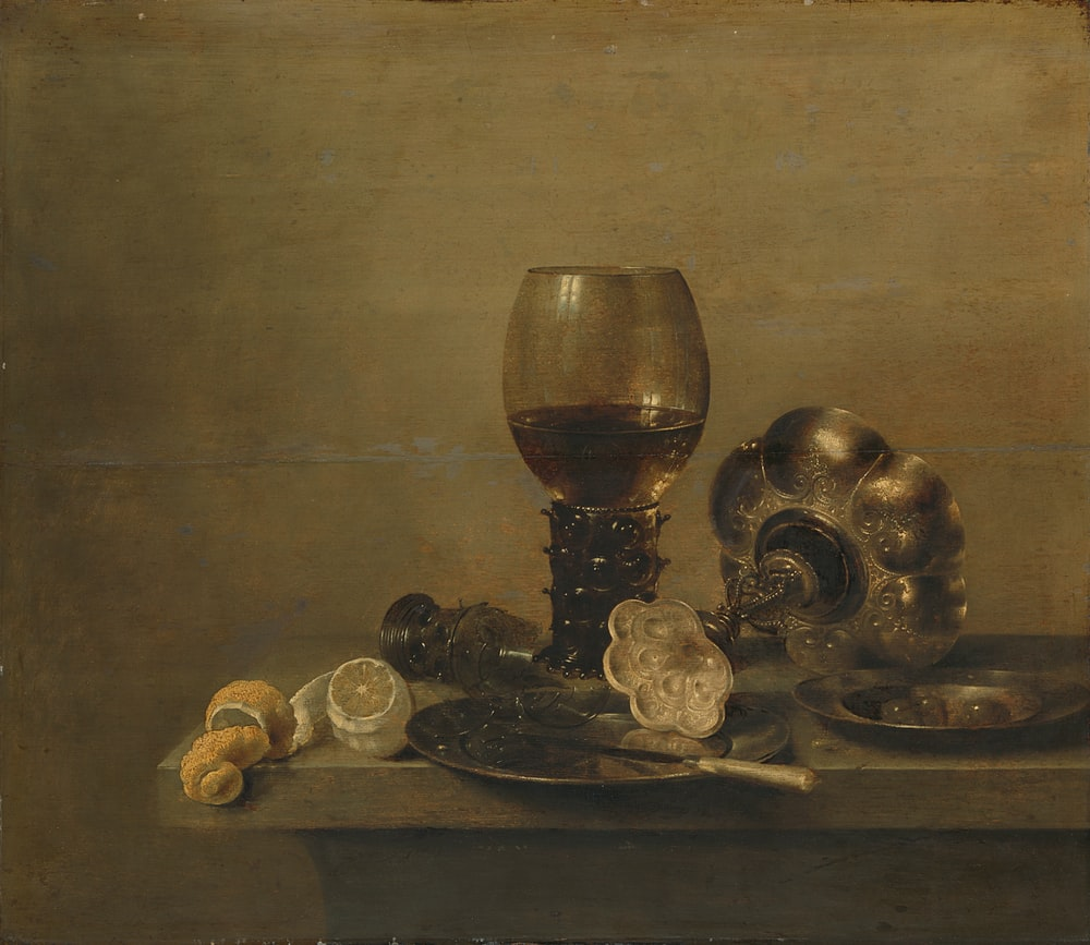 brass and silver trophy on brown wooden table