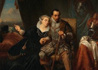 woman in black and brown dress beside man in brown coat