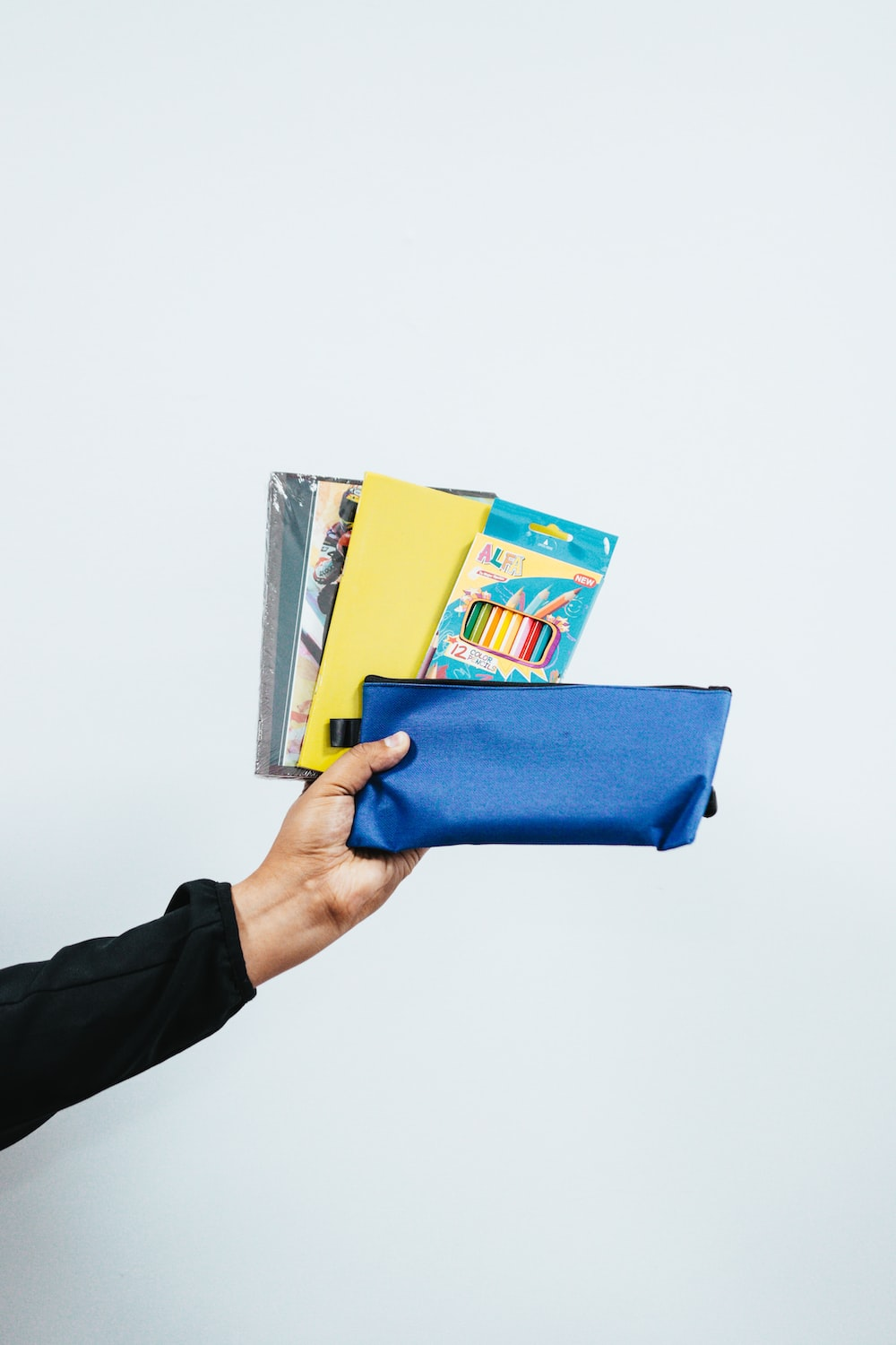 person holding blue leather tablet case