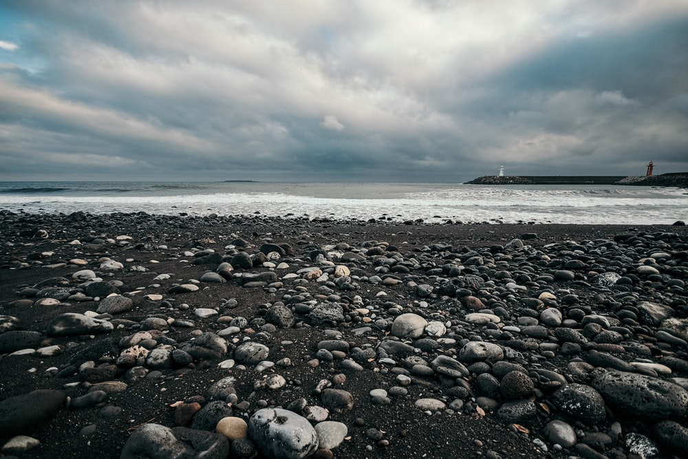 gray and white stones on seashore during daytime