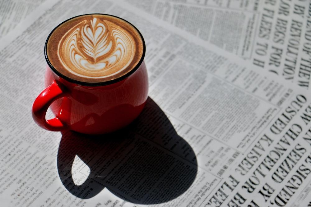 red ceramic mug with heart shaped coffee