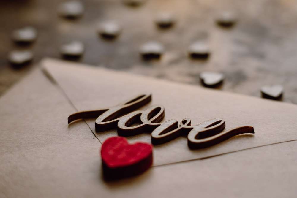 love you heart shaped on gray surface