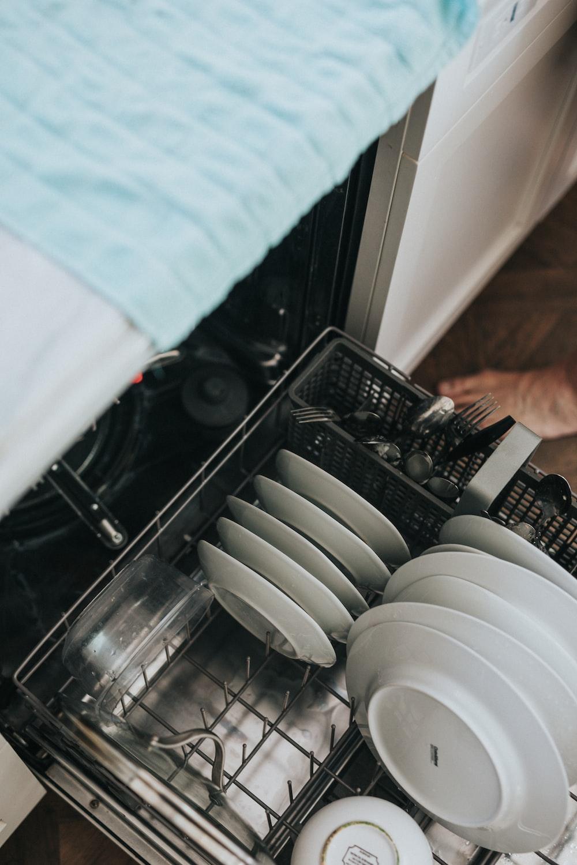 white ceramic plate on black dishwasher