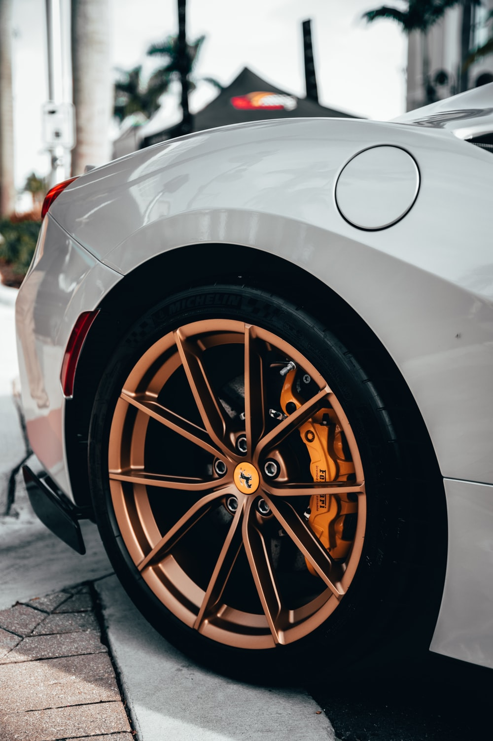 silver car with brown wheel