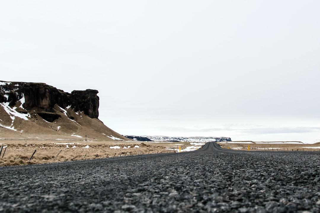 Black Asphalt Road Near Brown Rock Formation During Daytime - unsplash