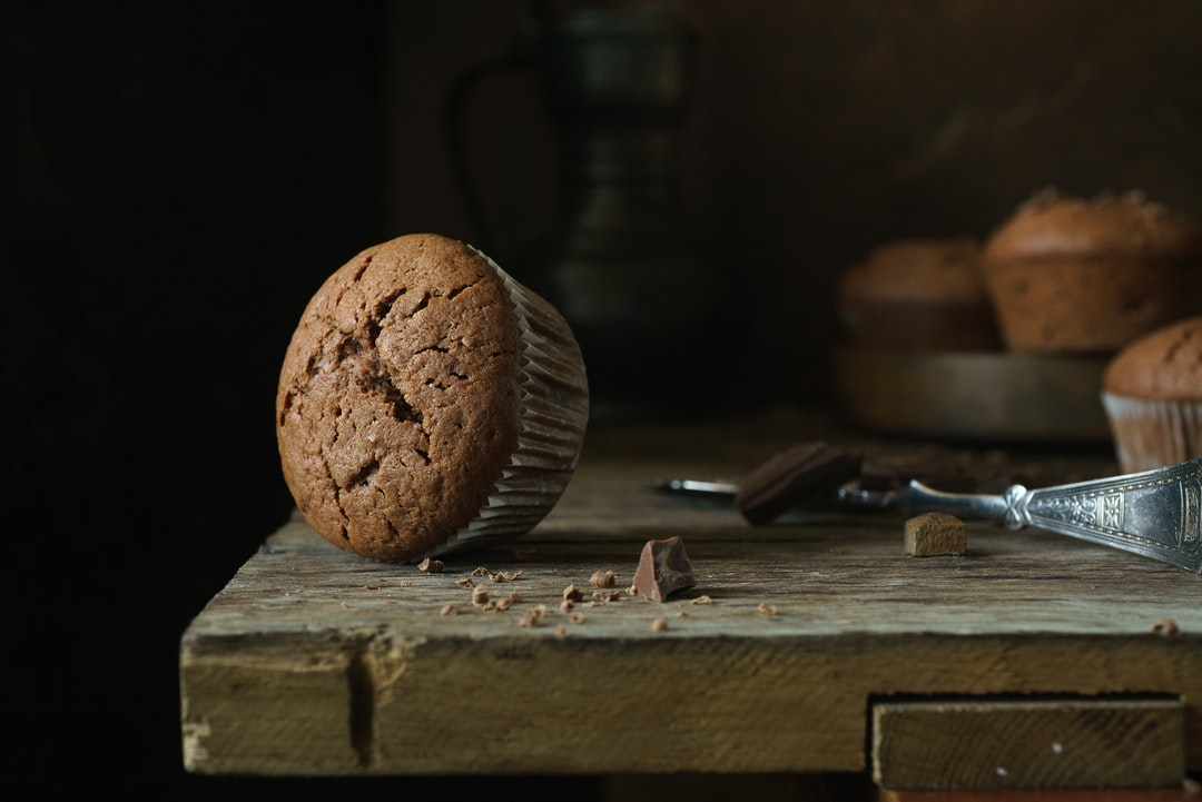 Muffin With Chocolate On A Wooden Background - unsplash