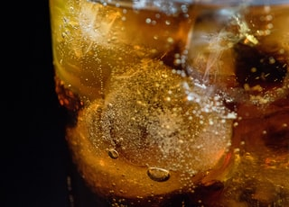 clear drinking glass with ice cubes and lemon