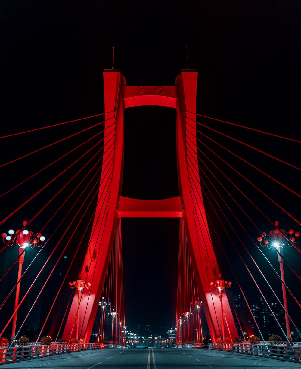 blue bridge with lights during night time