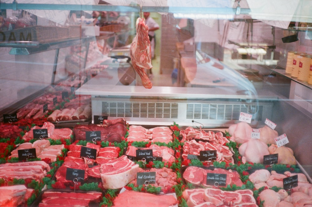 raw meat in clear plastic container