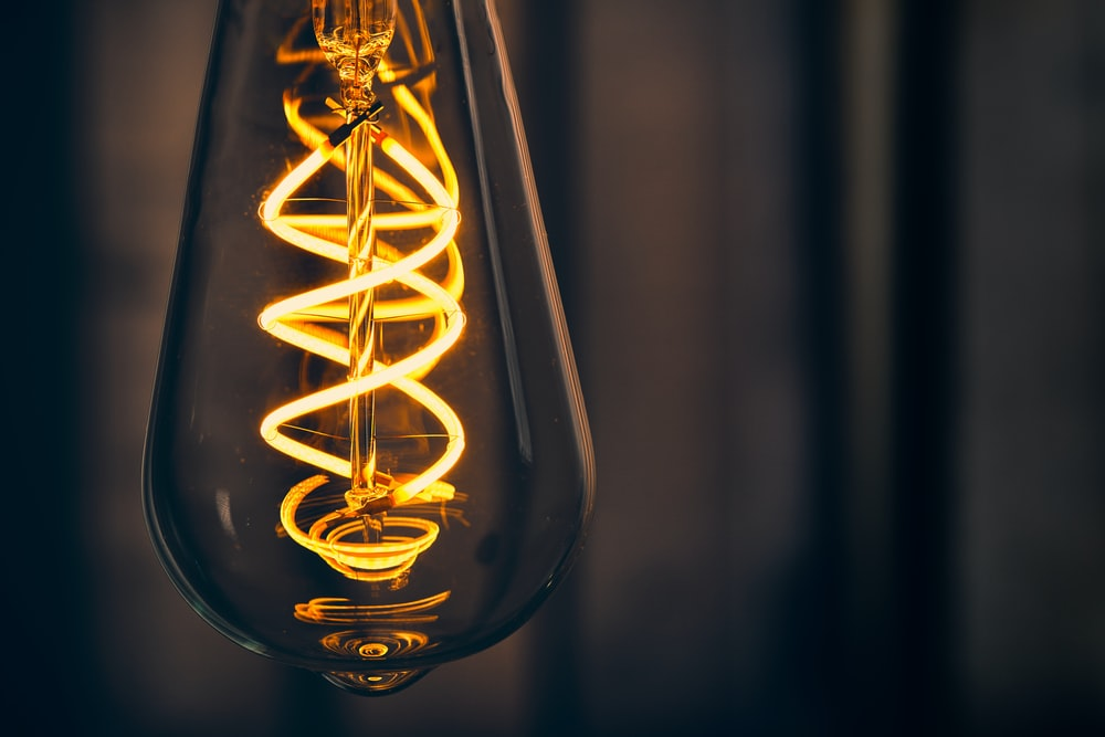 yellow light bulb in close up photography