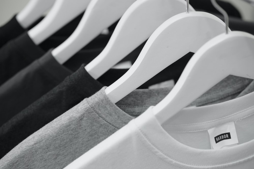 white and black crew neck shirt