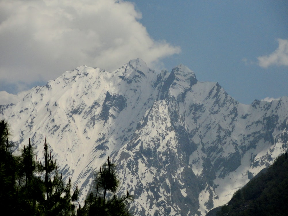 snow covered mountain during daytime