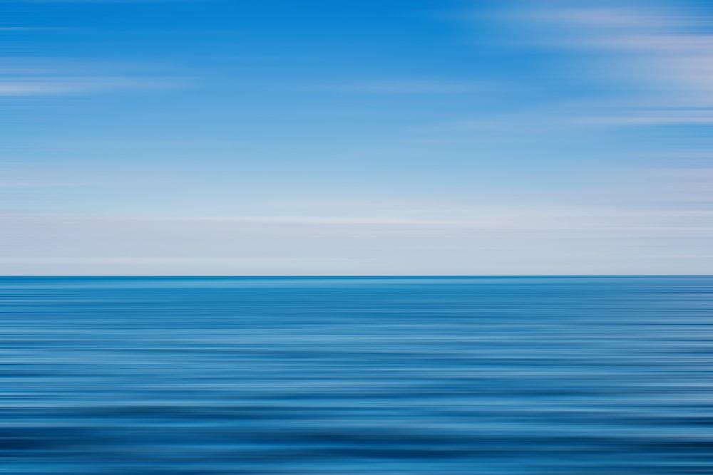 blue ocean water under blue sky during daytime