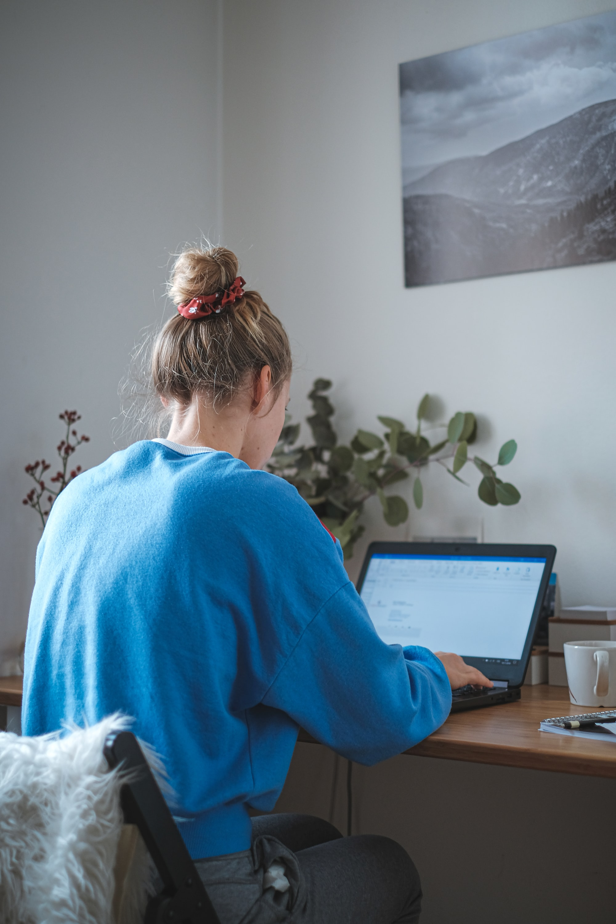 The young woman in her a home office