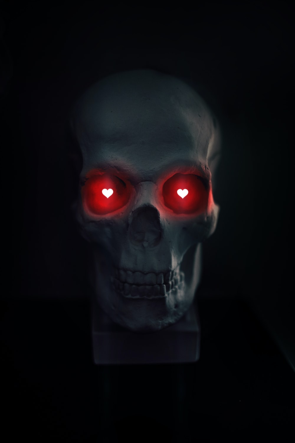 gray skull with red eyes