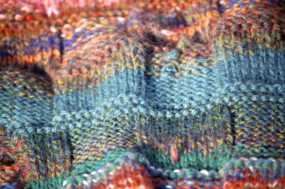 blue green and red knit textile