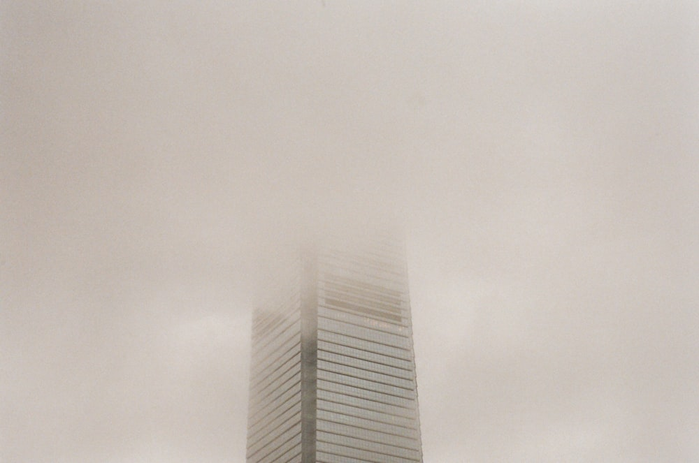 gray high rise building under white sky