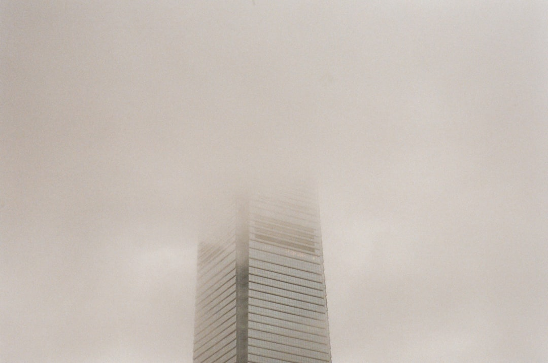 Gray High Rise Building Under White Sky - unsplash
