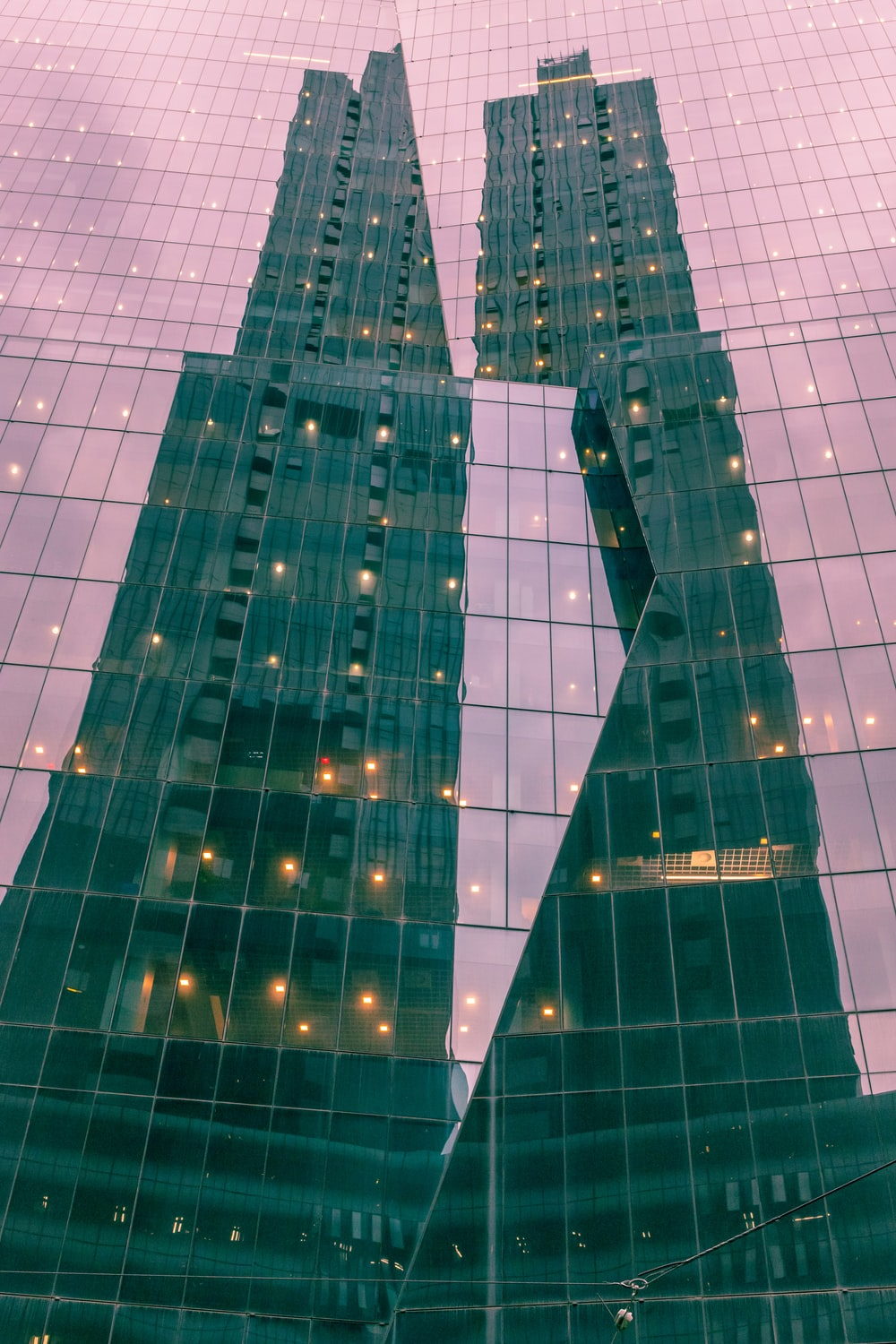 blue and white glass walled high rise building