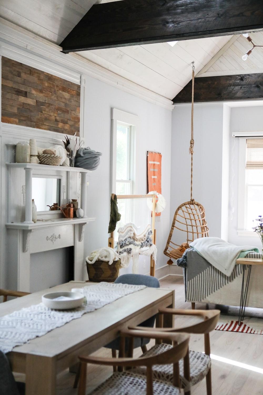 white wooden table near white wooden framed glass window