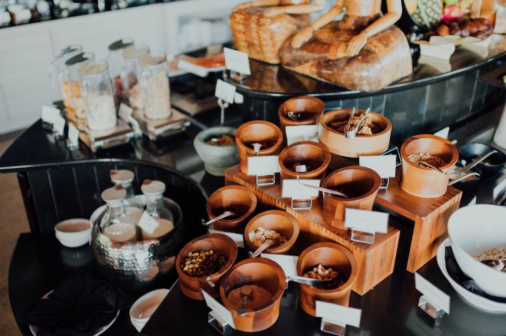 brown ceramic mugs on brown wooden tray