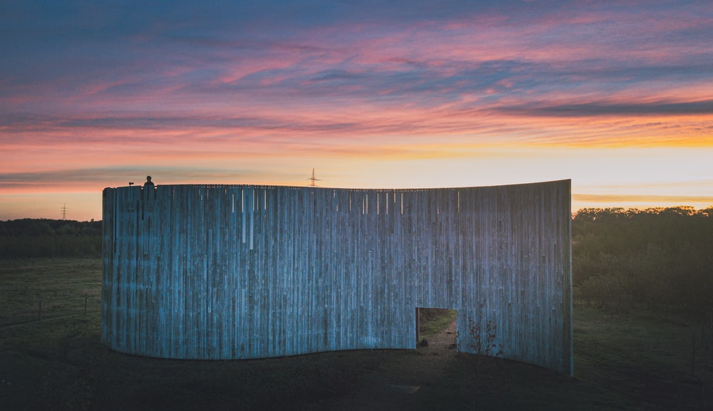 brown wooden fence during sunset