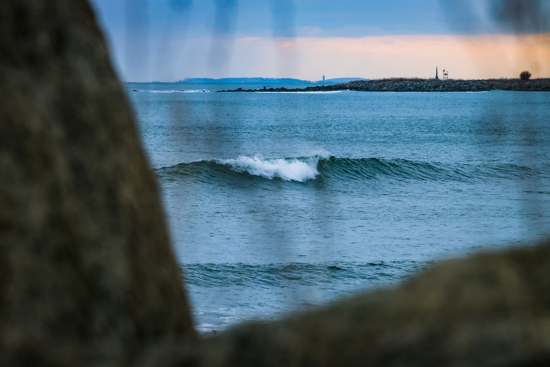 A frigid-cold wave breaking at sunset on New Hampshire's seacoast. A mellow blue wave results from some small swell and offshore winds. Follow on Instagram @wildlife_by_yuri