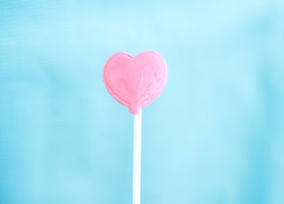 pink lollipop with white background