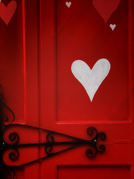 red wooden door with heart shaped white heart shaped