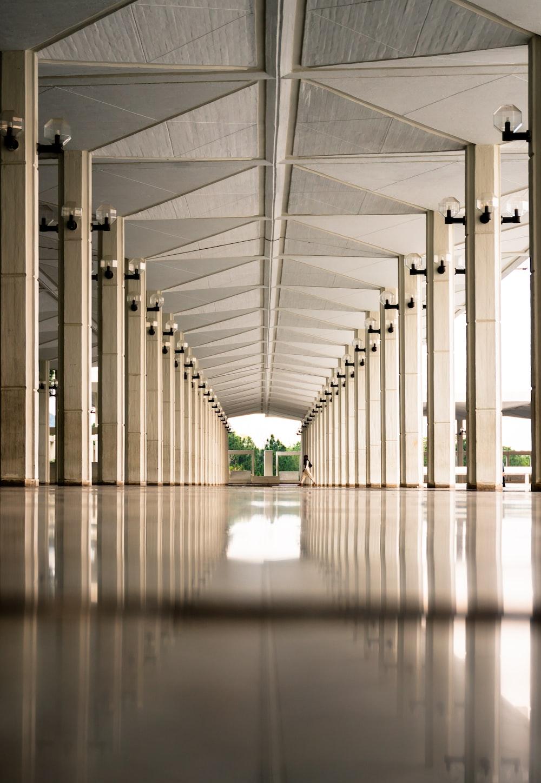 person walking on hallway during daytime