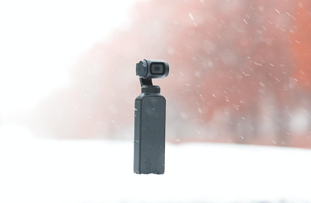 black camera on white surface