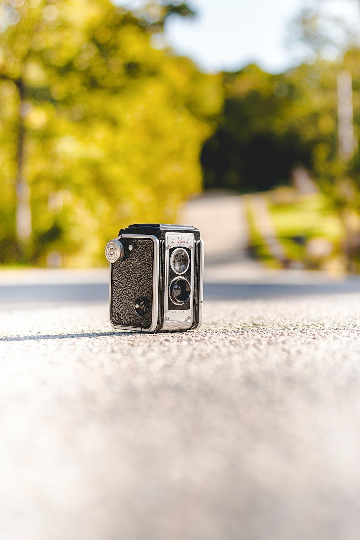 black camera on gray concrete road