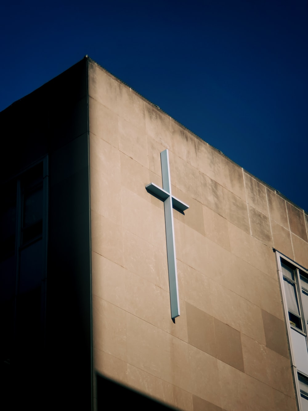 white cross on brown concrete building
