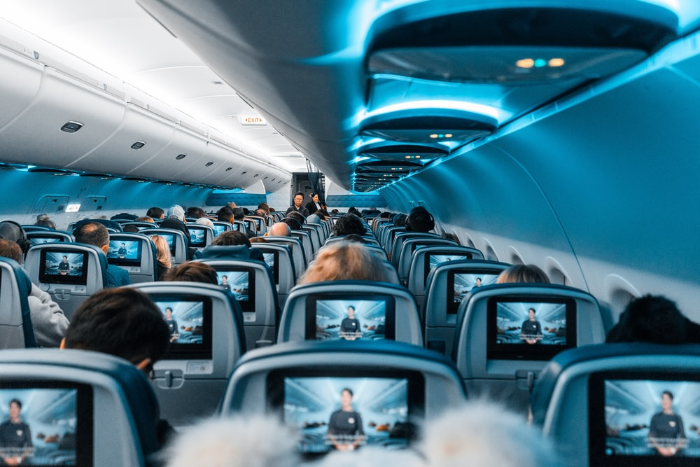people in airplane during daytime