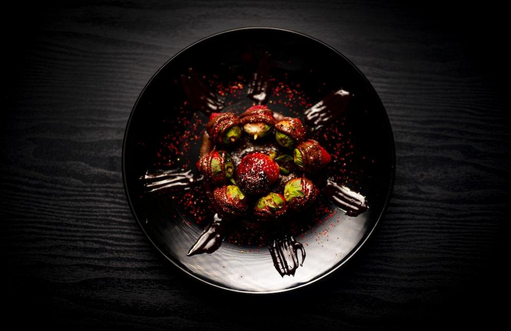 sliced strawberries on black ceramic plate