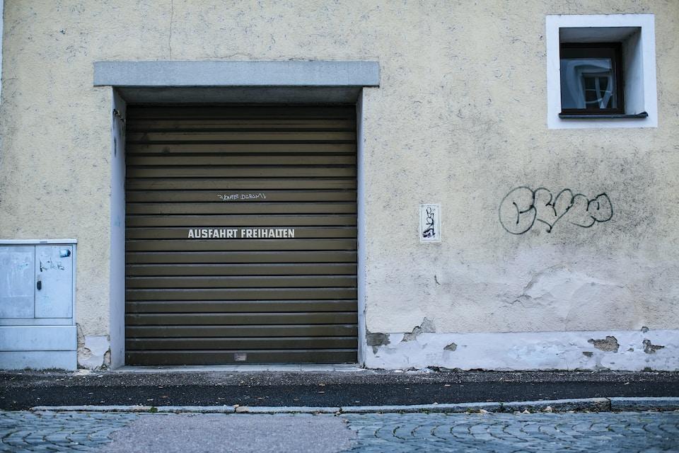 gray wooden door with black steel door