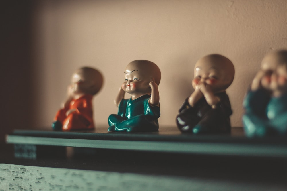 man and woman figurine on black table