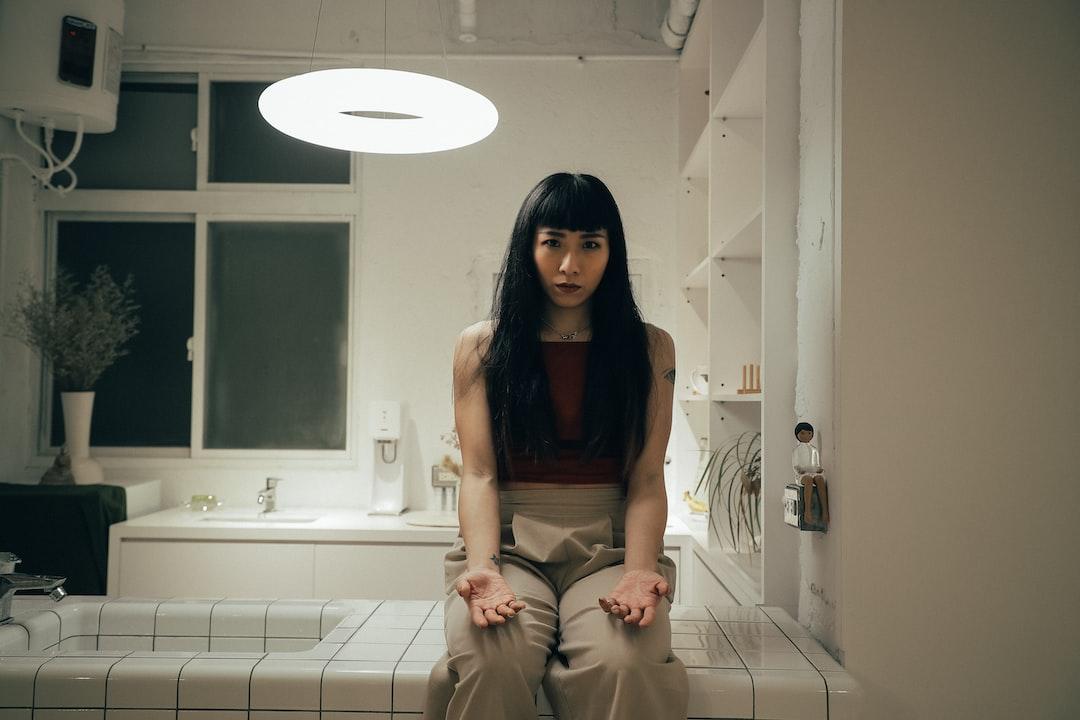 Woman In Brown Dress Sitting On White Ceramic Sink - unsplash