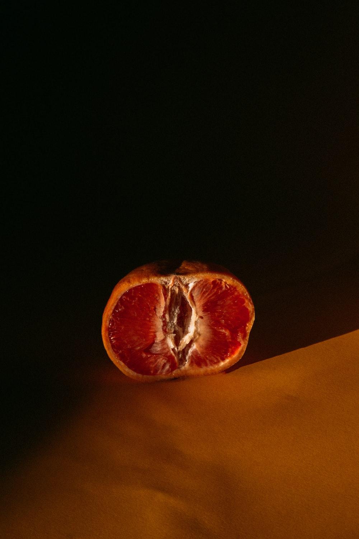 orange fruit on yellow textile