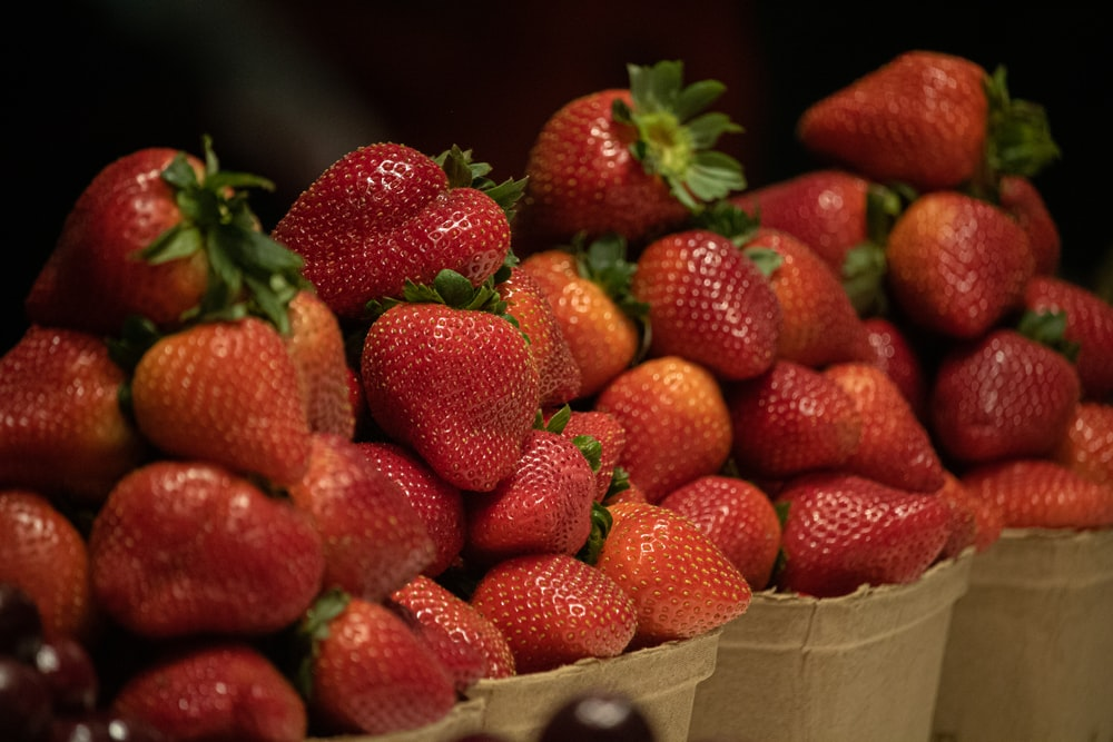 red strawberries in brown cardboard box