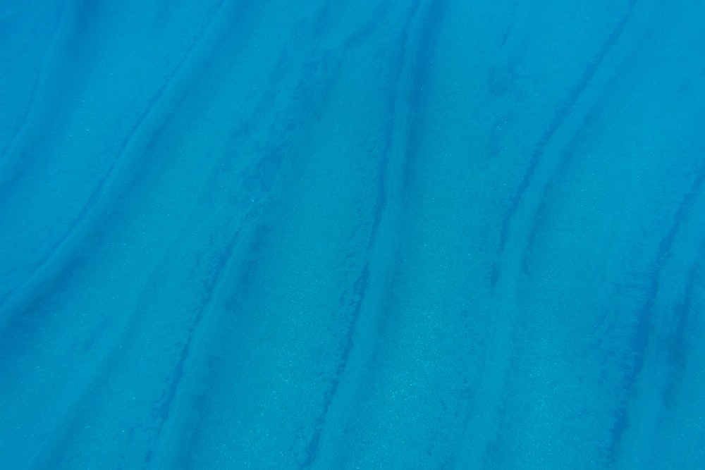 blue textile with white background