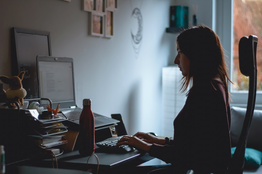 woman in black long sleeve shirt using computer