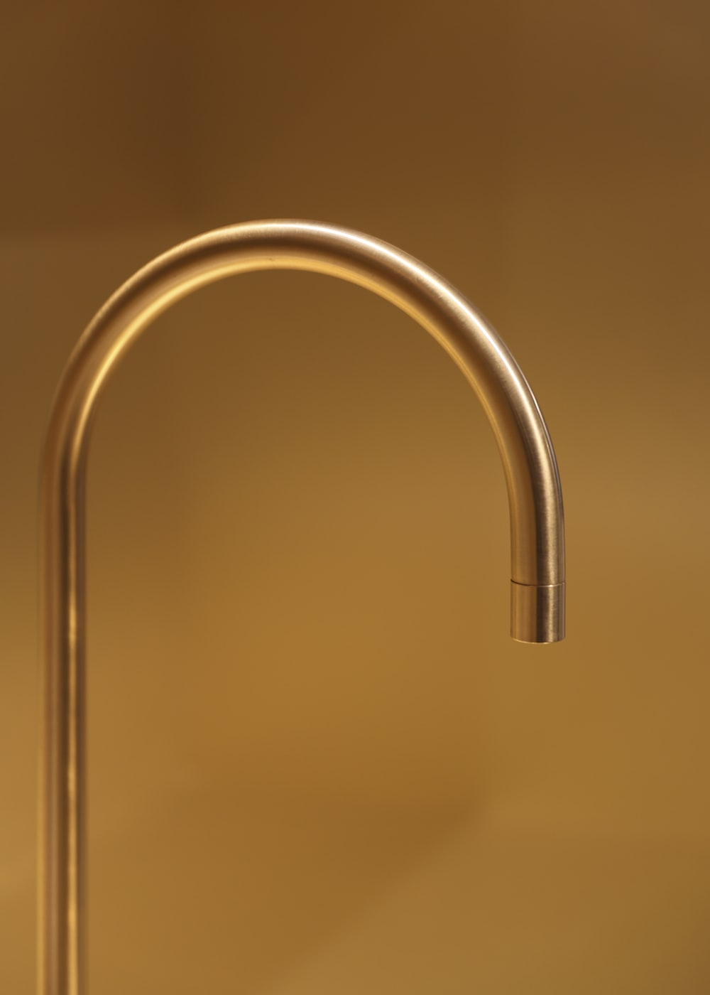 stainless steel faucet in close up photography