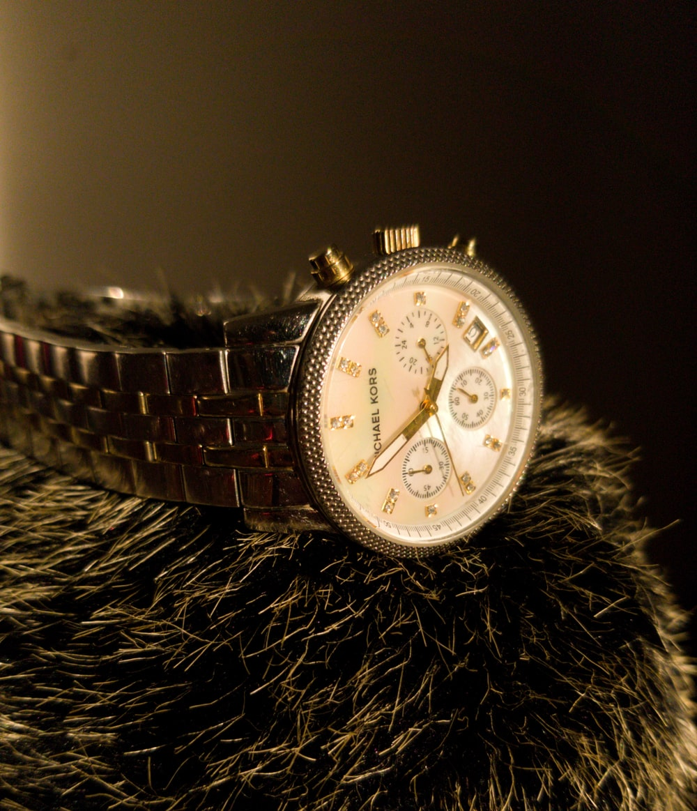 gold and white chronograph watch