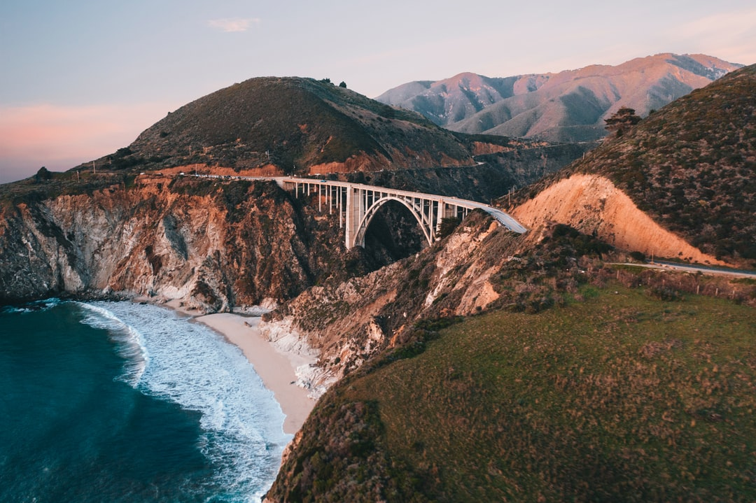 White Bridge Over the Sea During Daytime - unsplash