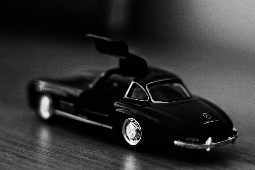 black porsche 911 on wooden floor