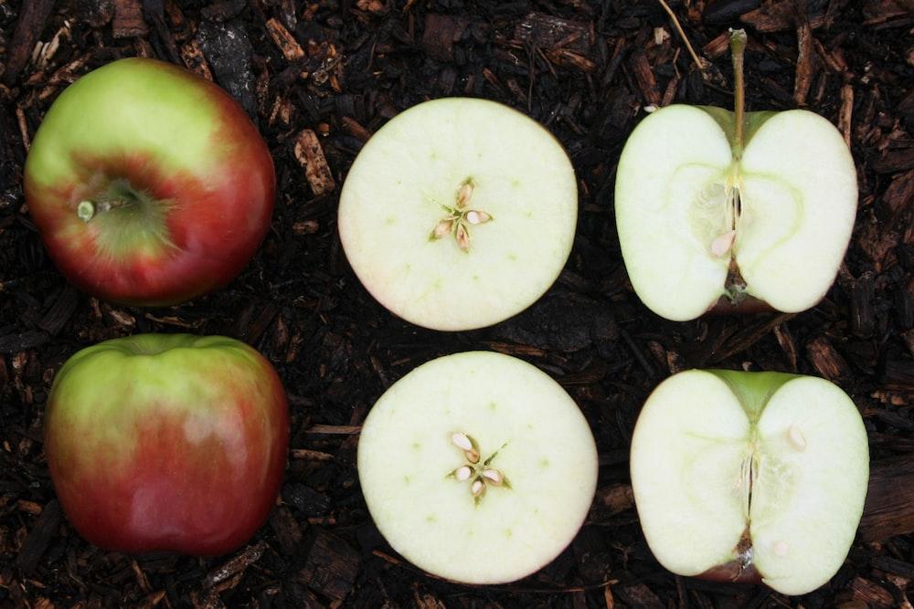 sliced apple fruit on ground