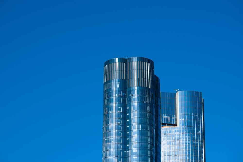 gray and black high rise building under blue sky during daytime