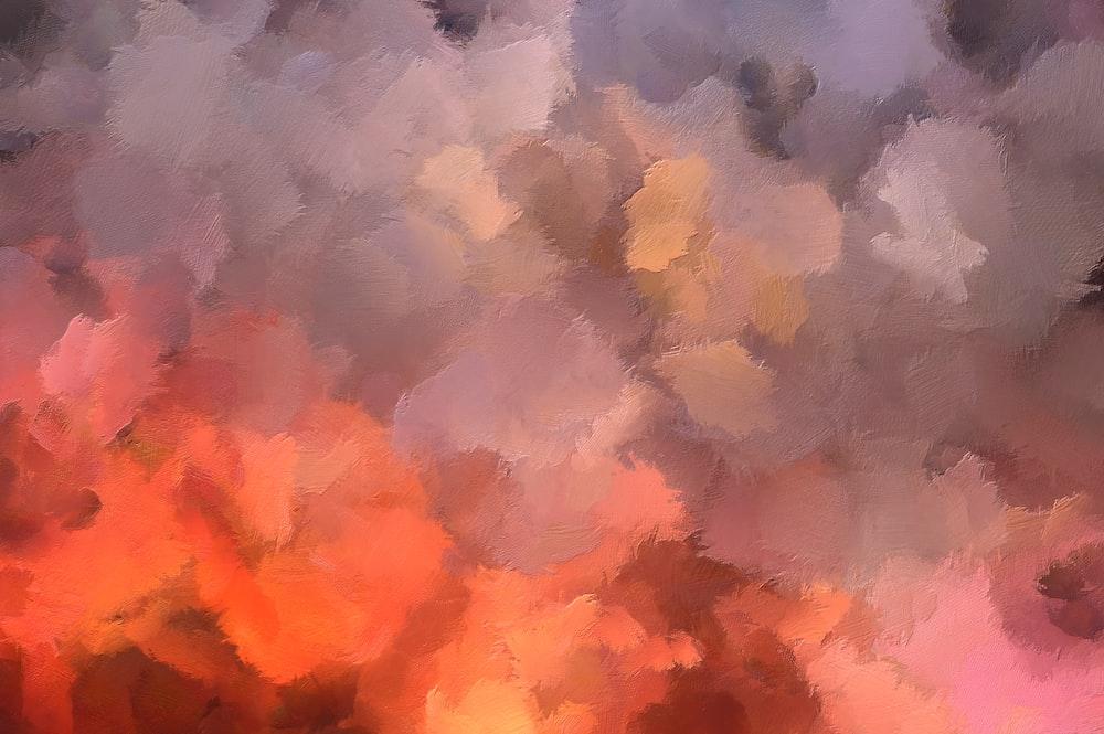 white and orange smoke on gray sky