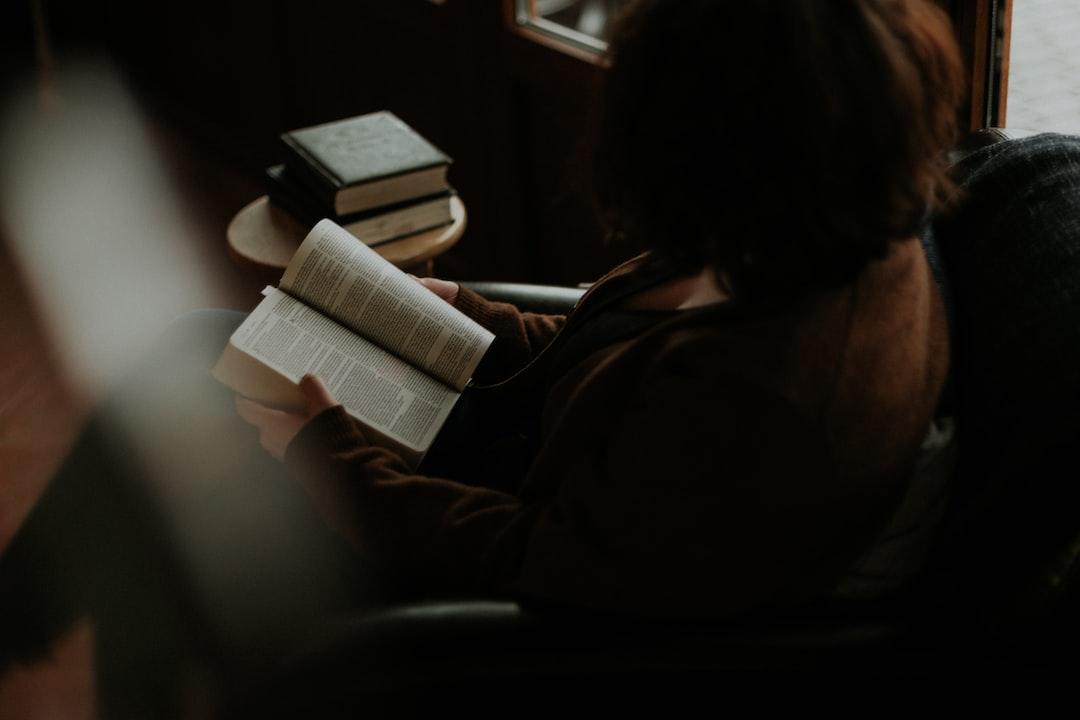 Woman Reading Book On Sofa - unsplash
